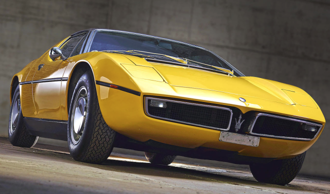 The front end of a Yellow Maserati Bora