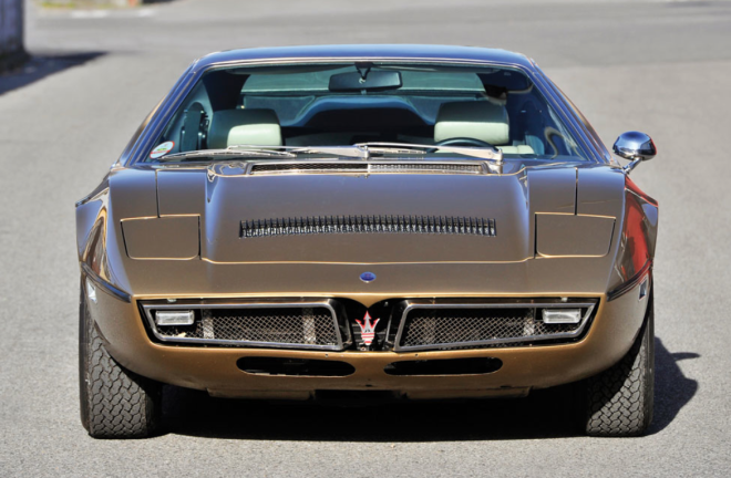 The nose of a gold Maserati Bora