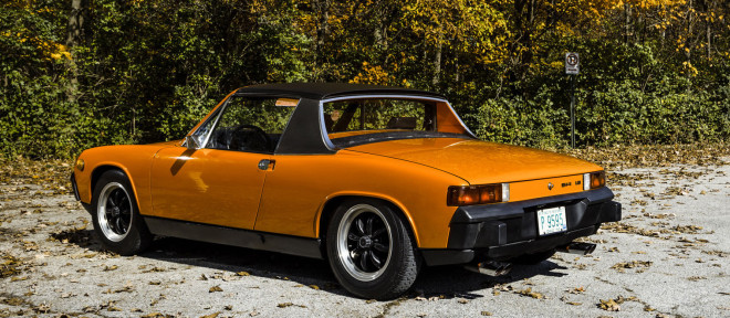 Rear 3/4 of an orange Porsche 914 financing