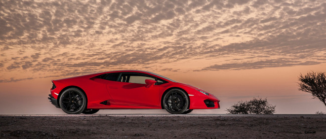 Profile view of red Lamborghini Huracan LP 580-2 financing