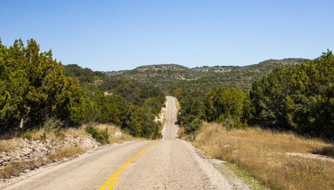 Three Sisters road stretching ahead in Texas