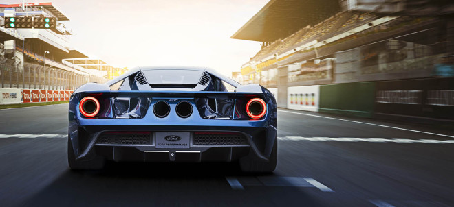 Rear end of a blue 2017 Ford GT on the track