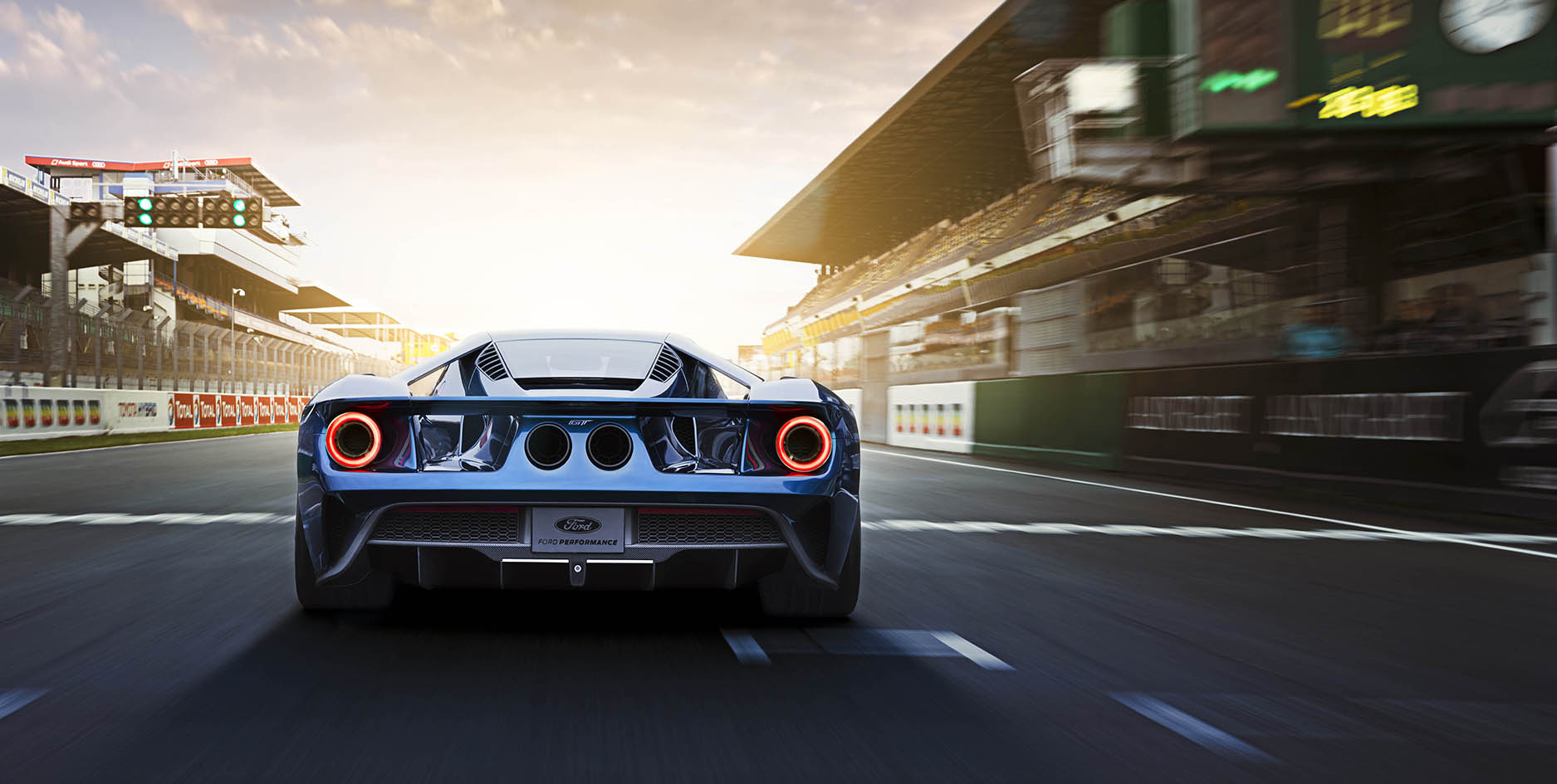 Rear End Of A Blue  Ford Gt On The Track