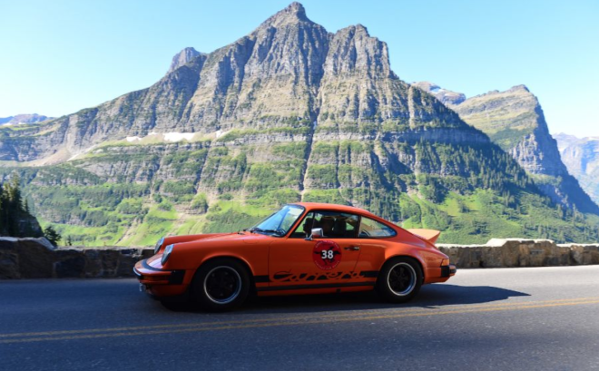 Lease an orange Porsche 911 Carrera