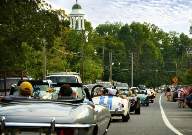 Parade through town with a classic leased with Premier