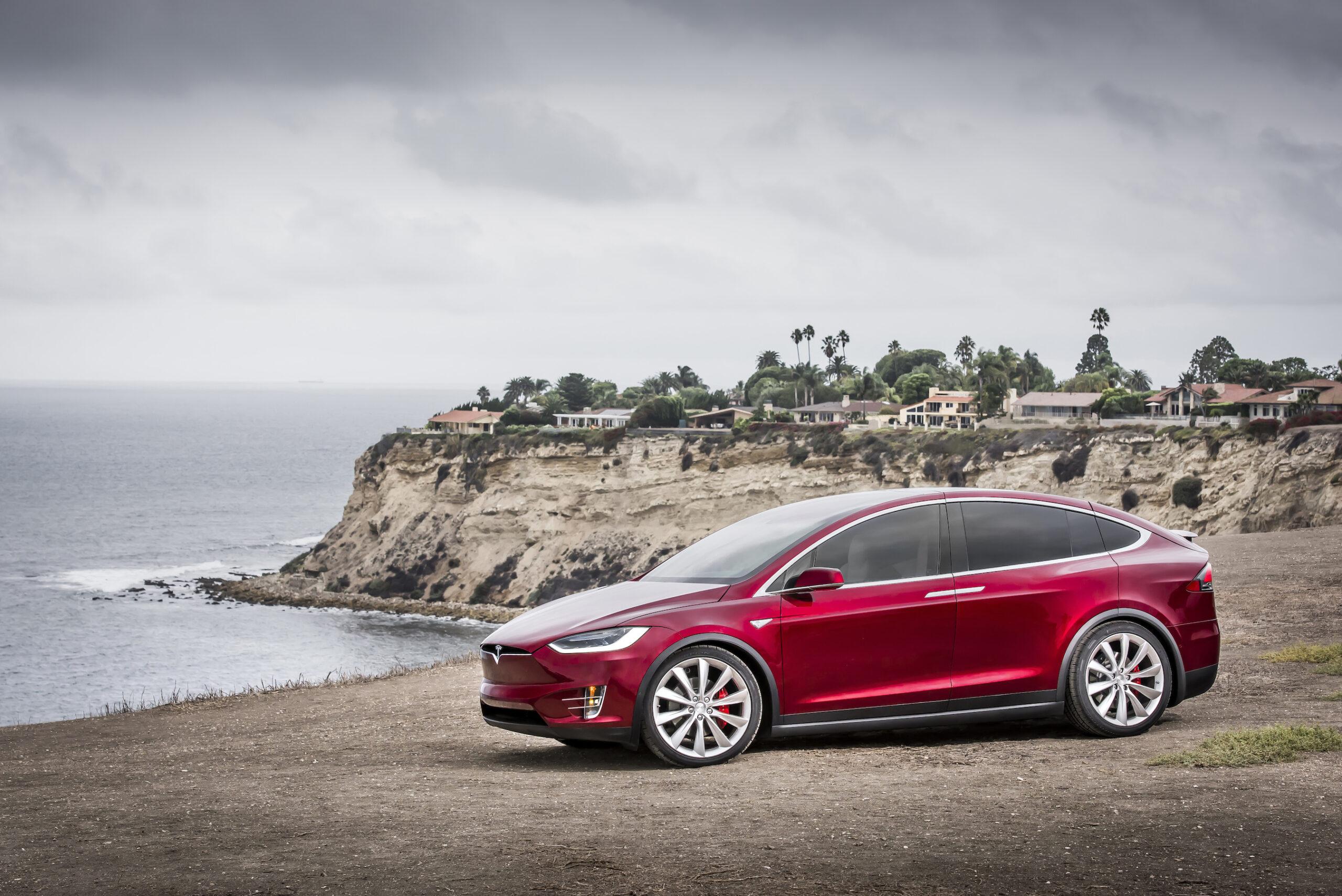 Red Tesla Model X On Shore