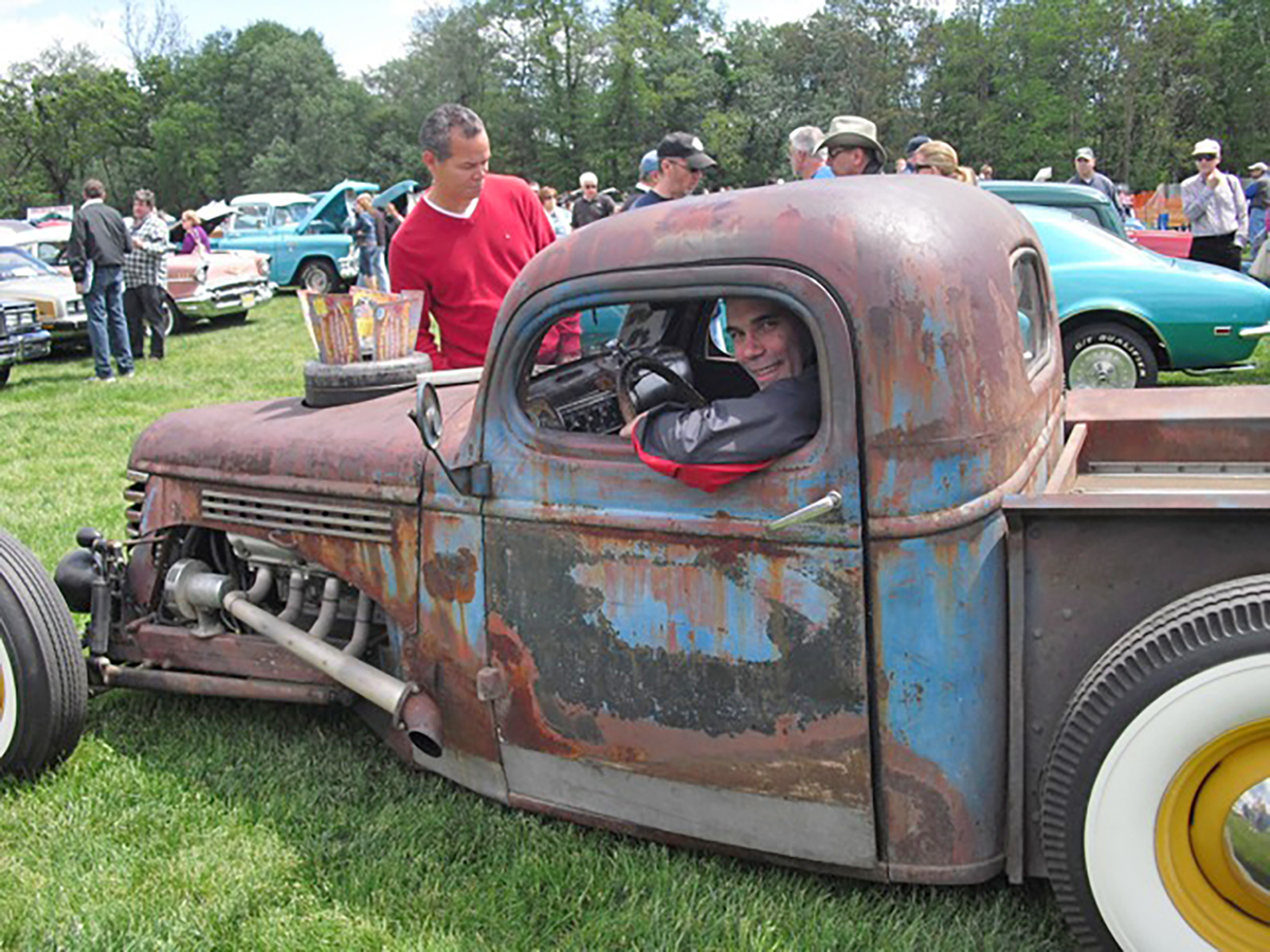 """Jim Koscs in a """"Rat Rod,"""" with a 1946 Chevy truck cab attached to a home-built chassis, with 1937 Ford front suspension and a custom four-link rear suspension.. Finance a vintage car with #pfs_leasing"""