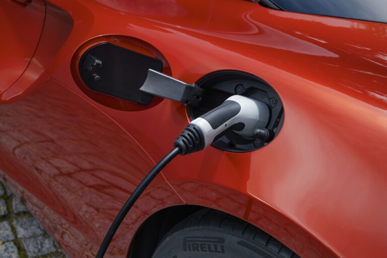 Vermillion red McLaren Artura 2022 charging. Finance a McLaren #pfs_leasing
