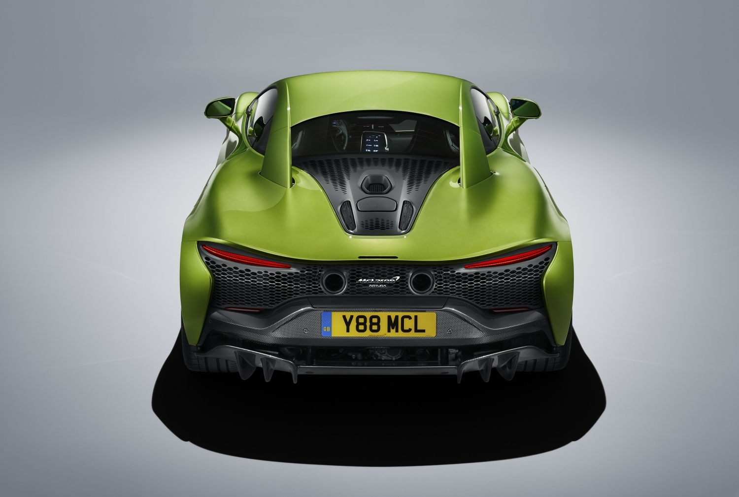 Rearview of Napier green 2022 McLaren Artura with narrow tail lights. Buy a McLaren with #pfs_leasing