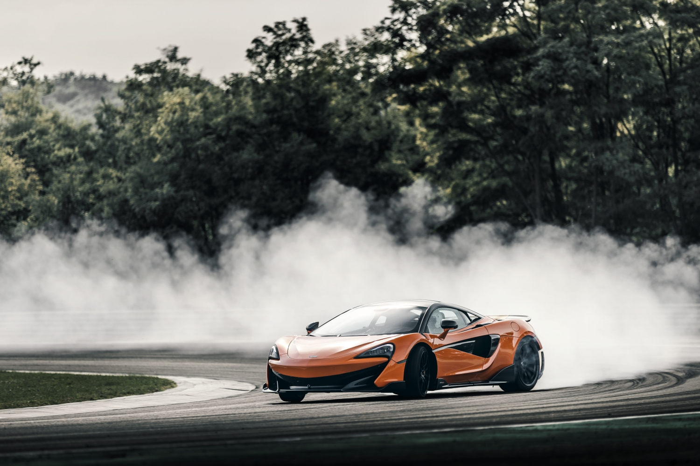 Model Perspective: McLaren 600LT Orange Longtail Tearing Up Track. SportsCar Financing