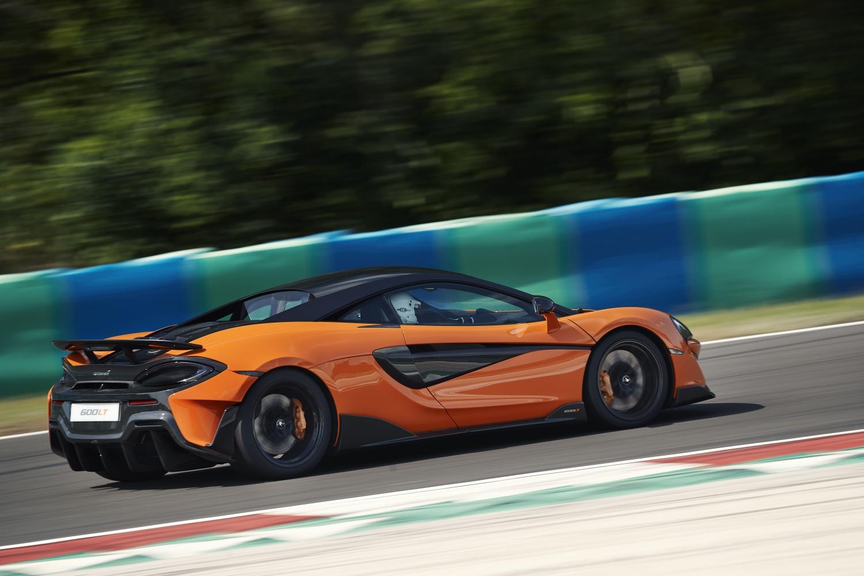 Model Perspective: McLaren 600LT Action Shot of McLaren Longtail Racing at High Speeds on Track. Track Life