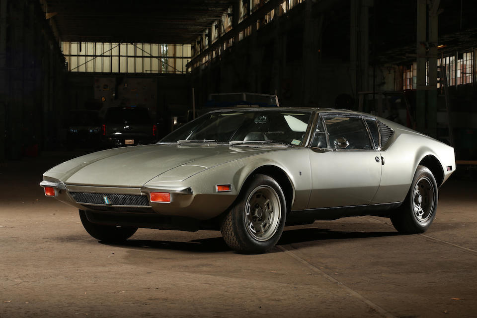 Brushed silver 1971 De Tomaso Pantera, in garage. Black leather interior. Classic Car Leasing is simple with Premier Financial.