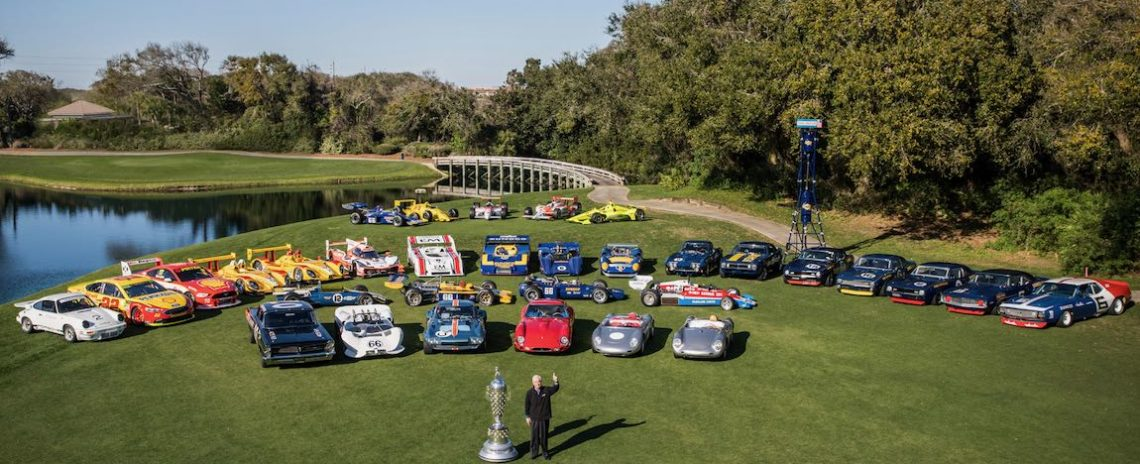 Roger Penske with Amelia Island Concours Line-up of Cars on Golf Course. Finance you dream car with Premier
