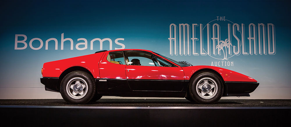 Red Ferrari on Bonham's bidding stage at Amelia Island Auctions