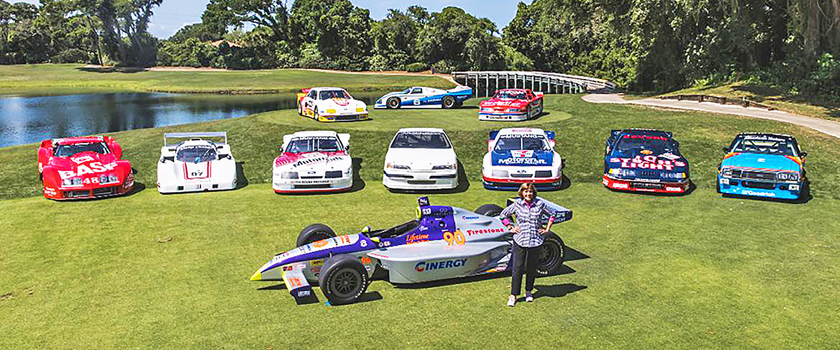 Lyn St. James and racecars at Amelia Island Concours. Classic Car Loans