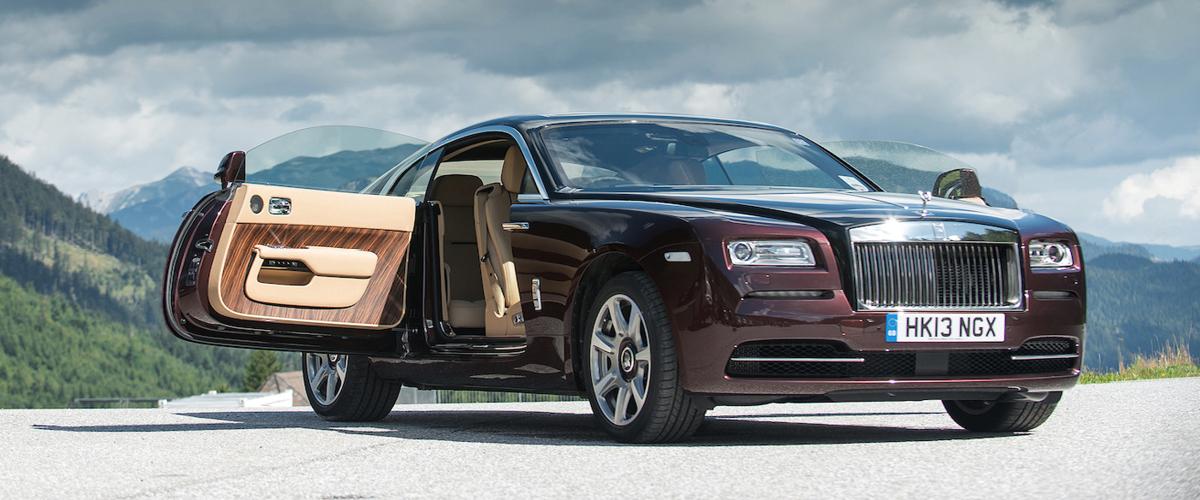 Rolls-Royce Wraith coach doors open against a mountiain skyline. Luxury Leasing.