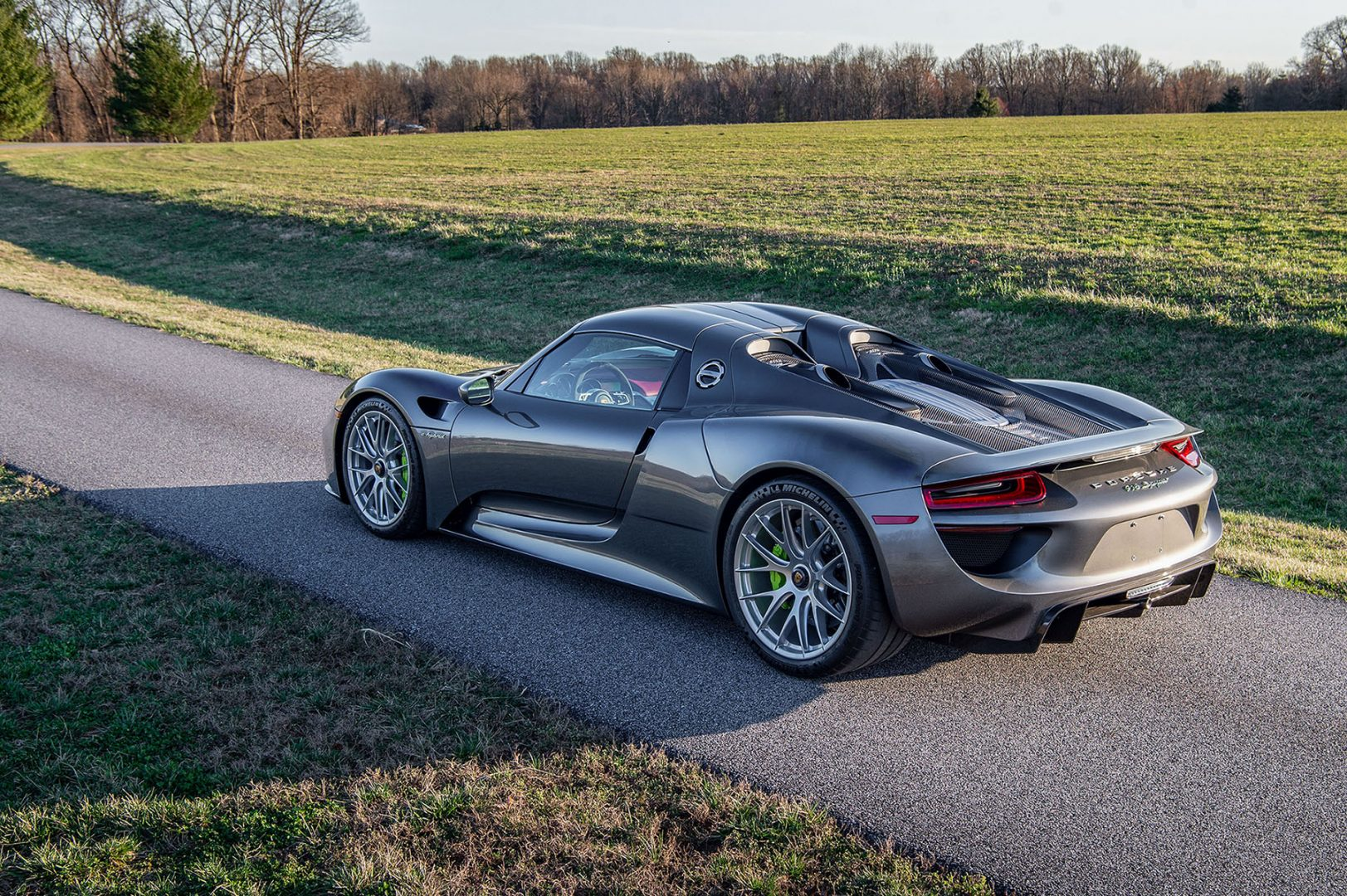 Silver Porsche 918 Spyder rear three-quarter view, view from above, green calipers; Perfect Porsche, PFS Simple Lease