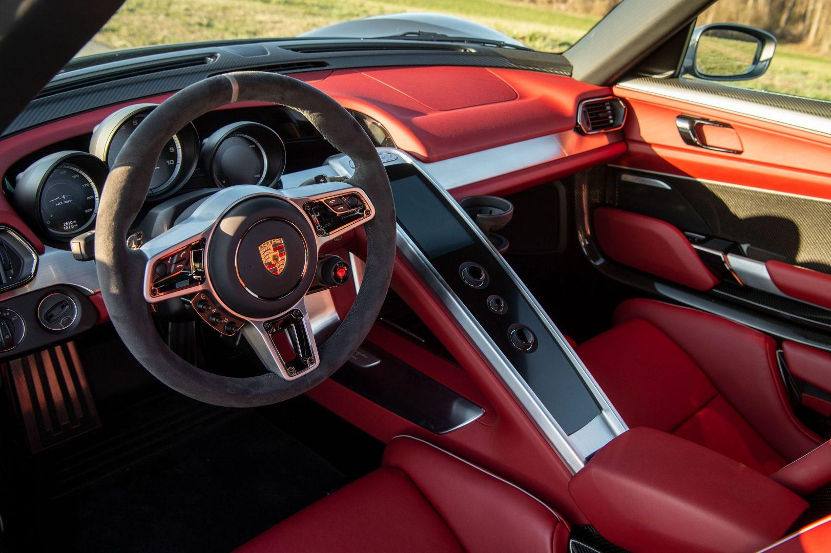 Silver Porsche 918 Spyder red cockpit leather interior; Lease a Porsche with Premier