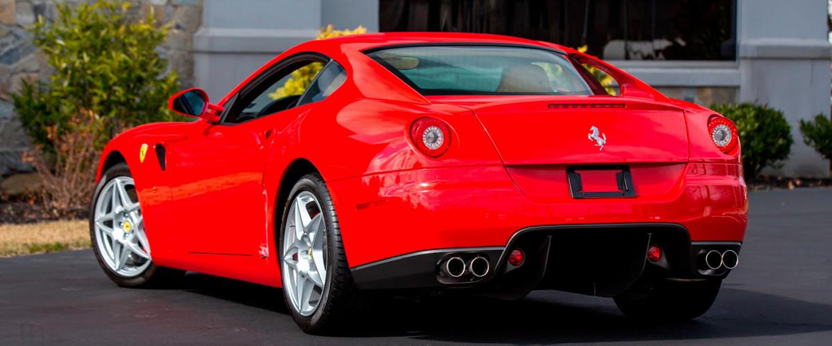 Red Ferrari 599 GTB rear left view