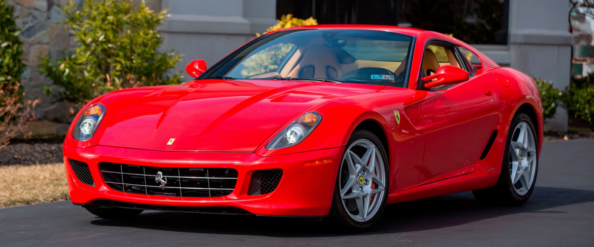 Red Ferrari 599 GTB front left view